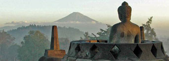 Vairocana on the top of Borobudur looking at the volcano Mt Merapi