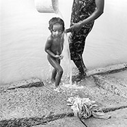 Mother bathing her child, Tangalla 1991