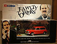 Boxed model ensemble of Basil Fawlty about to strike his car with the branch of a tree