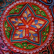 Star pattern in embroidered wall hanging